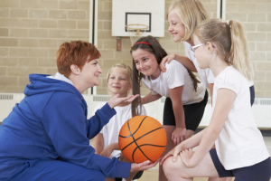Teacher Giving Team Talk To School Basketball Team