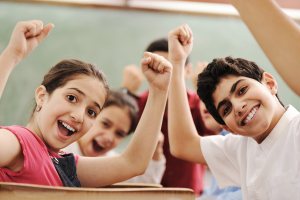 Happy children smiling and laughing in the classroom (1)